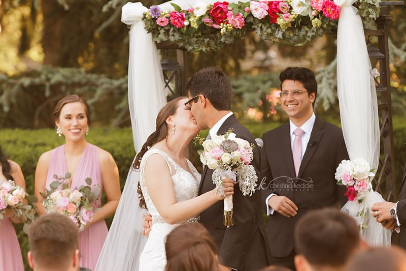 Wedding ceremony first kiss in rose garden | Christina Keddie Photography | Princeton NJ wedding photographer